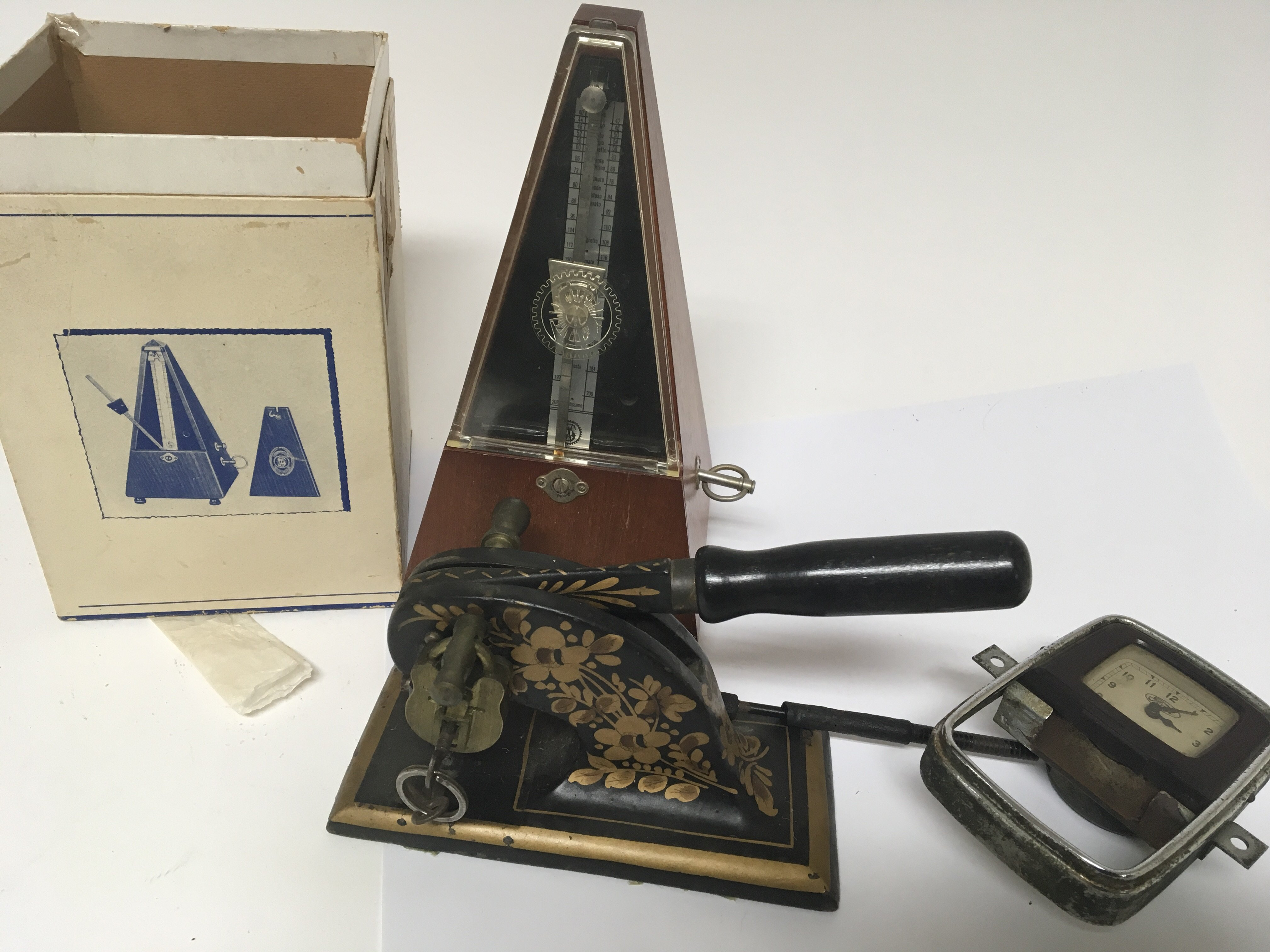 Lot 1853 - A cased Metronome a cast metal and painted paper s