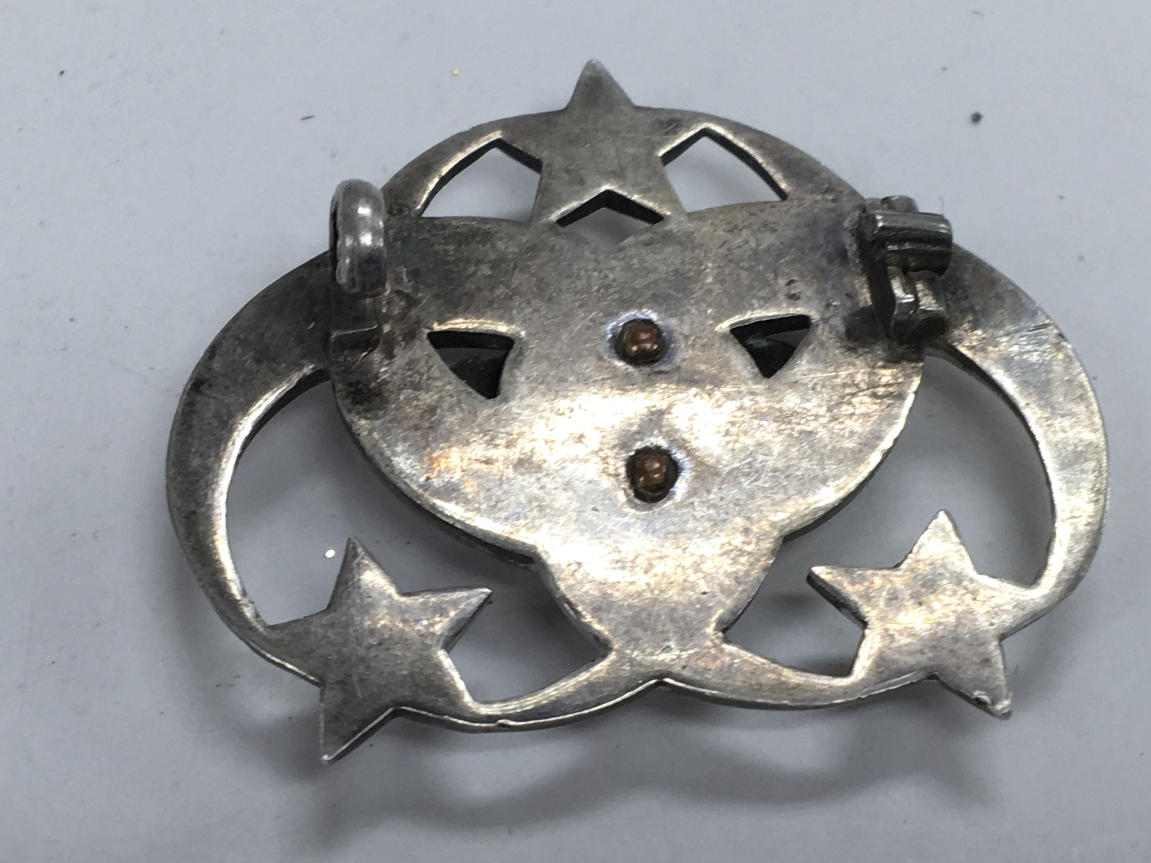 Lot 172 - A small silver brooch mounted with a Royal Crown -