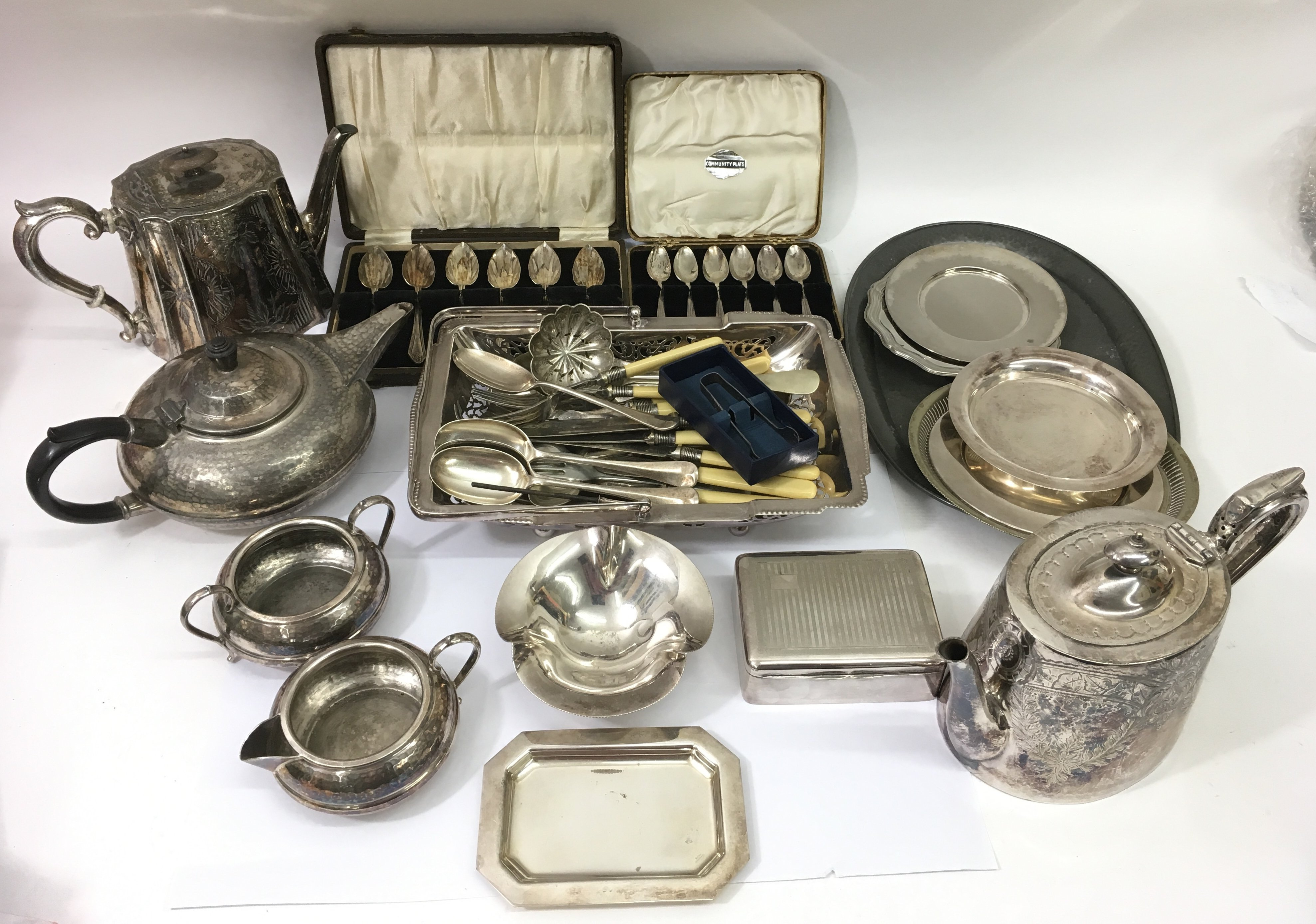 Lot 530 - A collection of silver plate including coffee pots