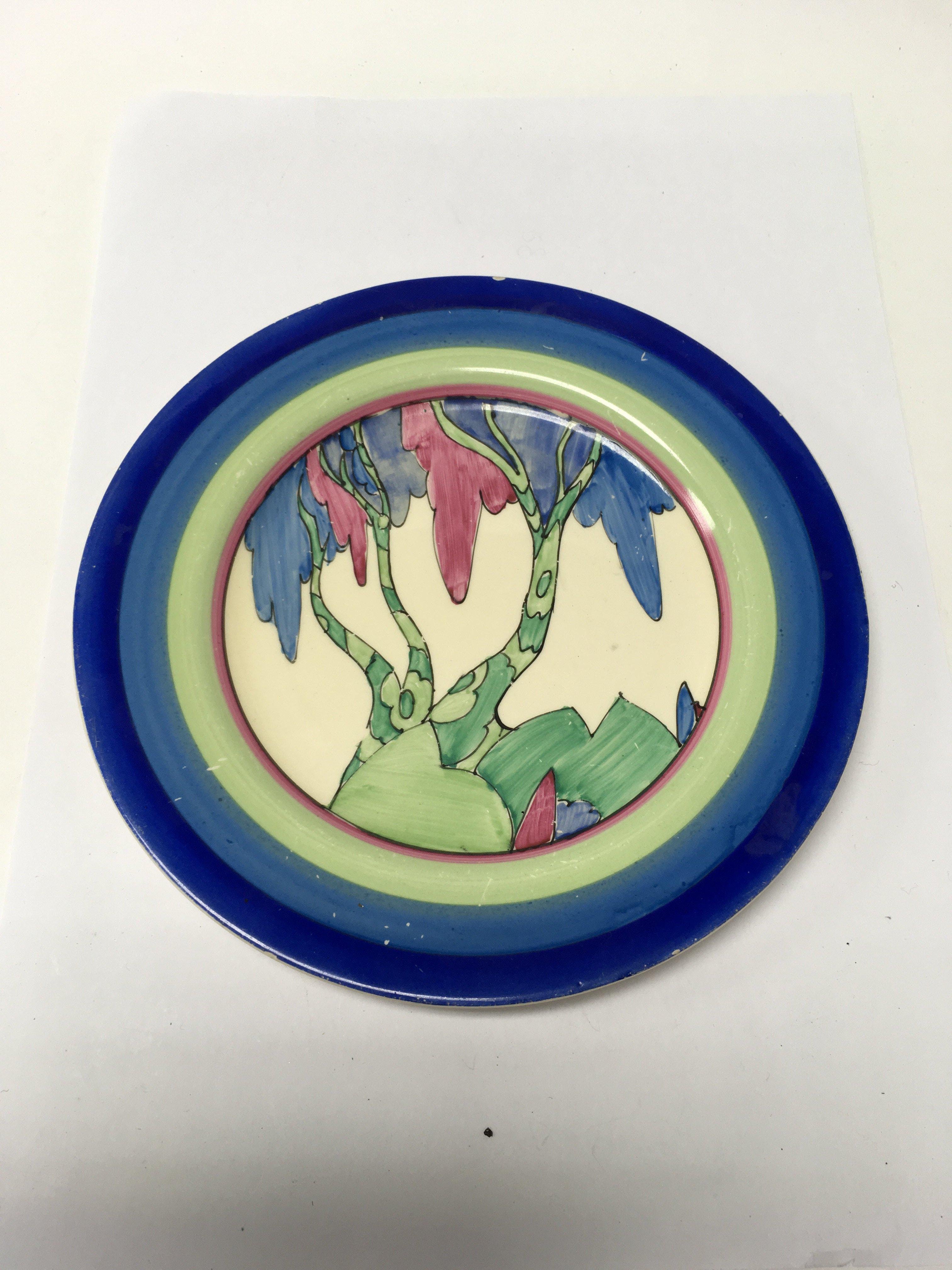 Lot 779 - A Clarice Cliff Rudyard tea plate 18 cm , scratche