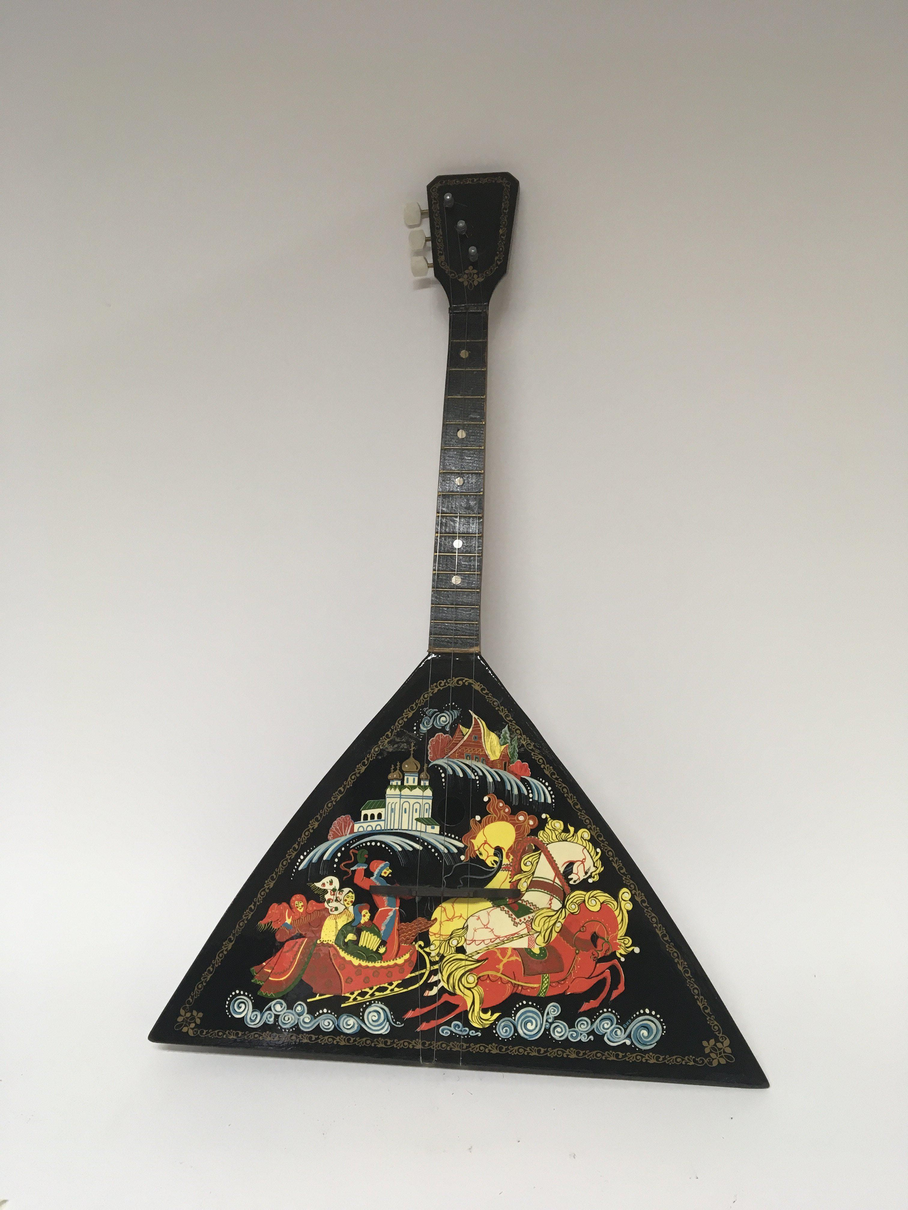 Lot 1836 - A Russian three string Balalaika decorated in the