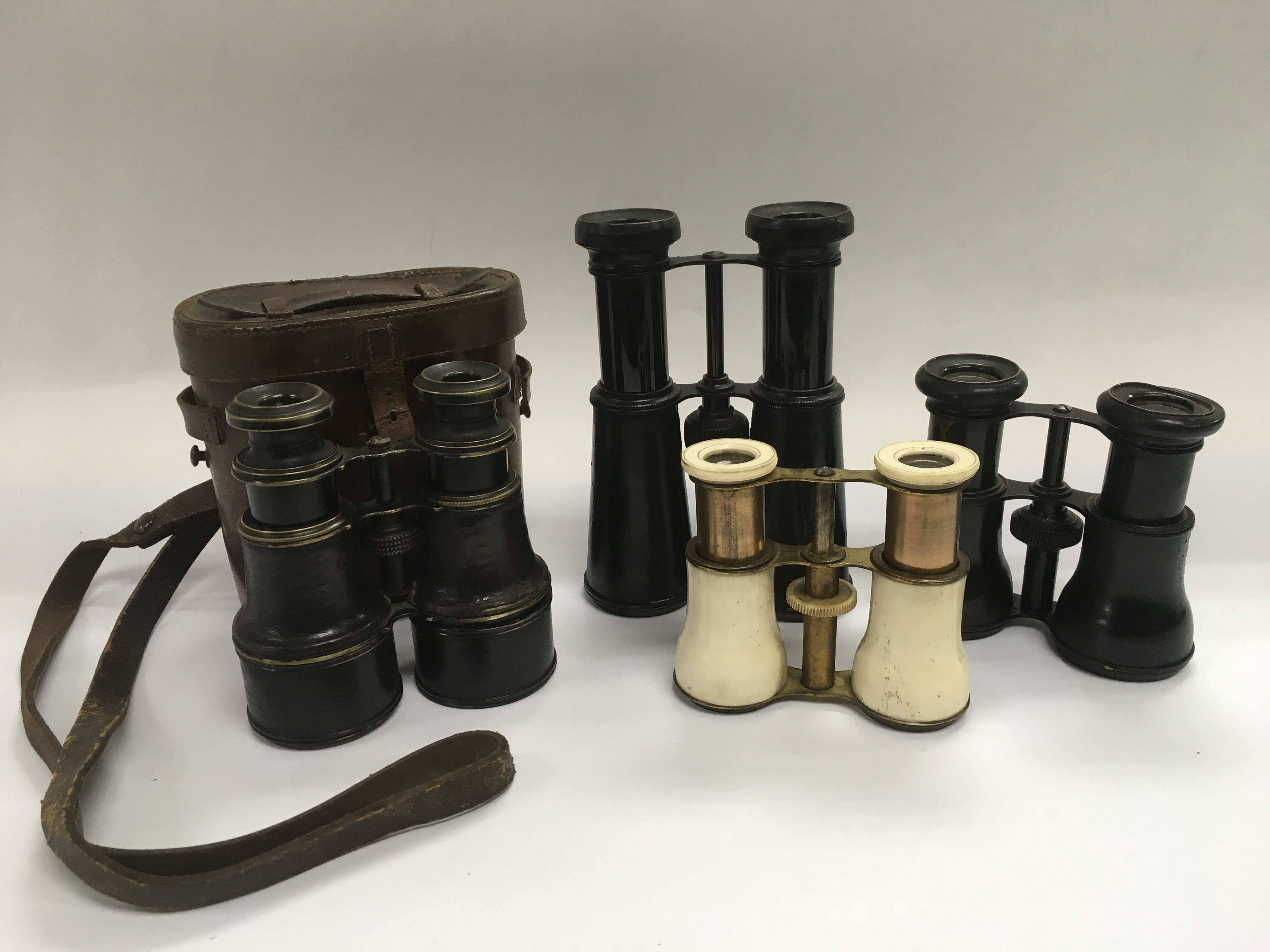 Lot 1839 - Four pairs of binoculars including a pair with bon