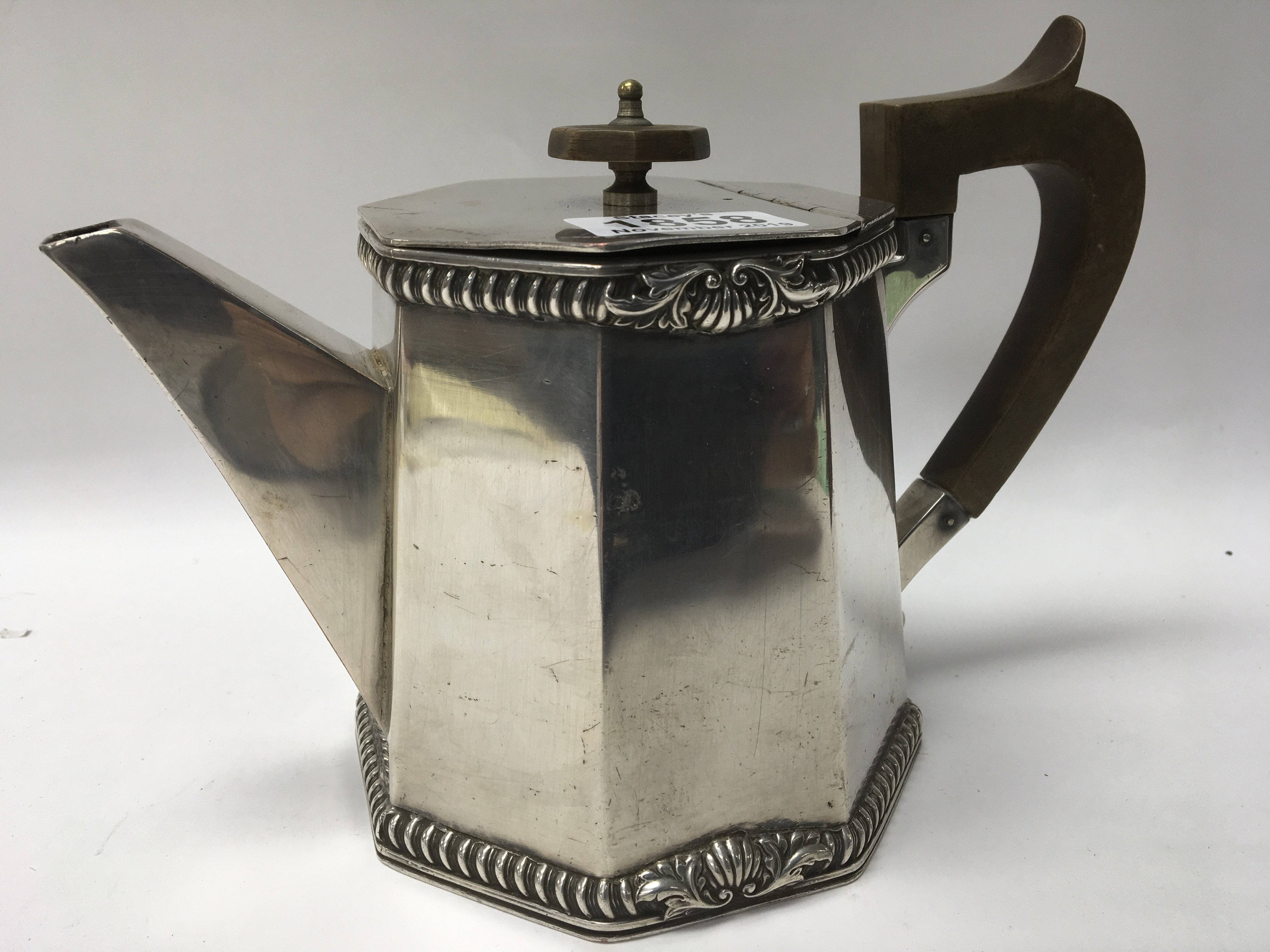 Lot 1858 - A silver plated octagonal teapot with solid silver mounts- see underneath