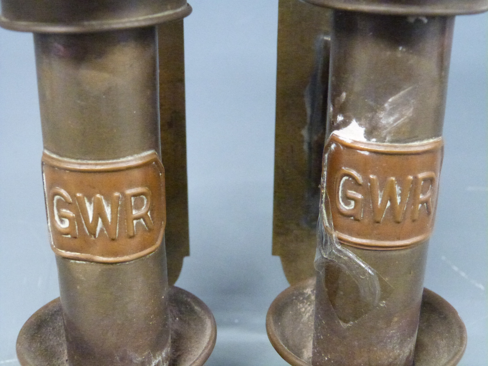 Lot 17 - London Transport tri colour hand lamp, height 30cm and a pair of lamps marked GWR, height 37cm