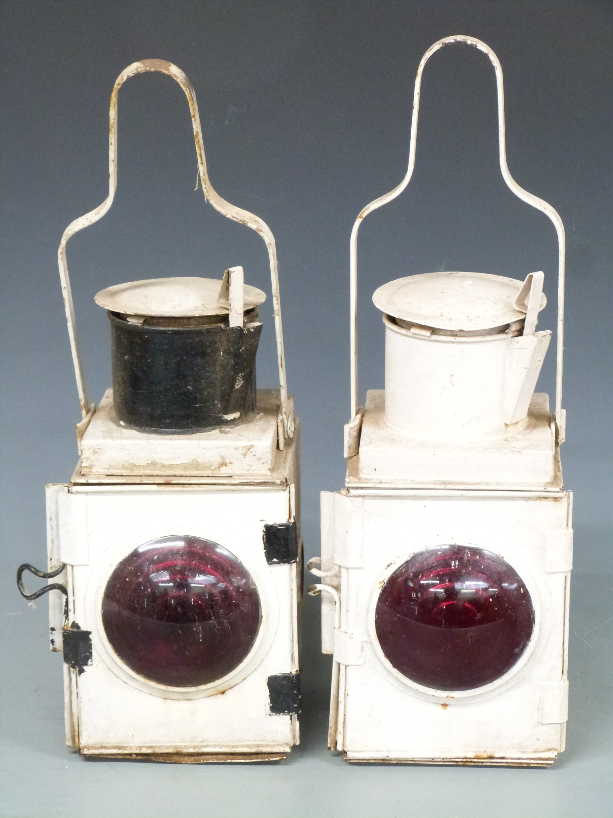 Lot 12 - Two railway or similar brake or tail lamps, height 52cm