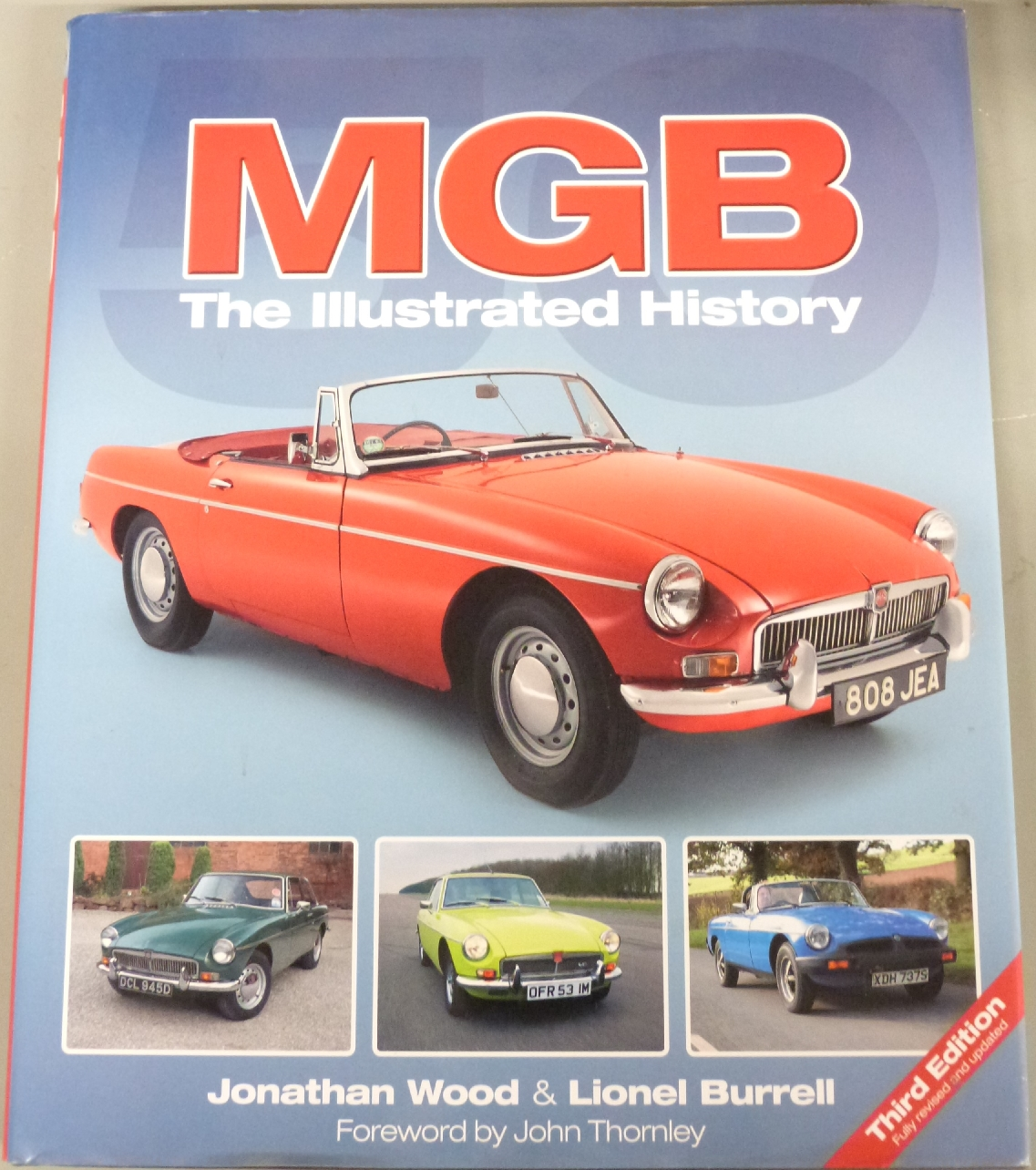 Lot 4 - A large quantity of Haynes car manuals and other motoring related books, including VW, BMW, MG,