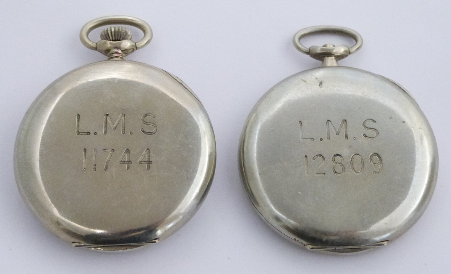 Lot 40 - Two London Midland and Scottish railway keyless winding open faced pocket watches each with