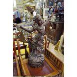 Lot 1490 - A 19th century Burmese carved hardwood figural gong,88cm high.