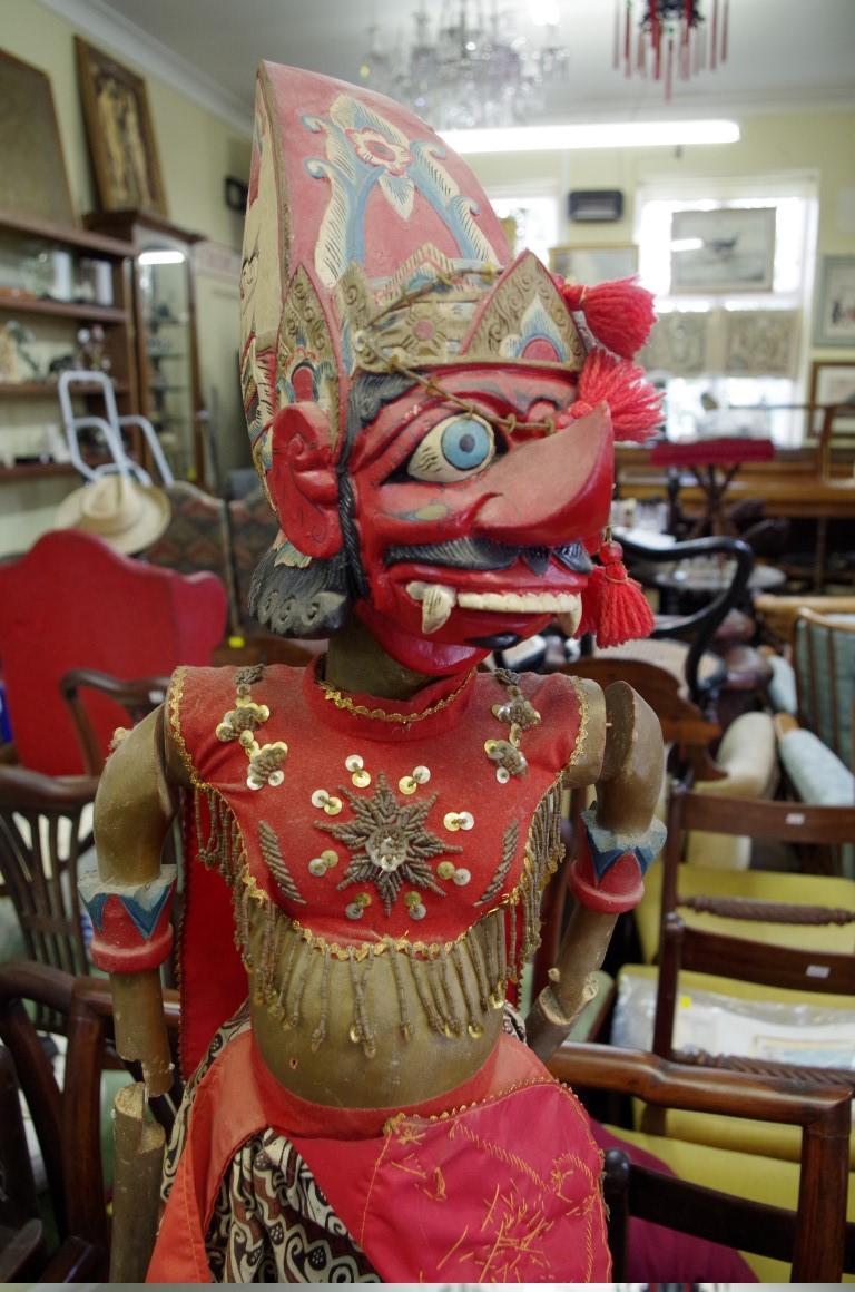 Lot 1489 - An Indonesian carved and painted wood Rahwana marionette, on stand, total height 103.5cm.