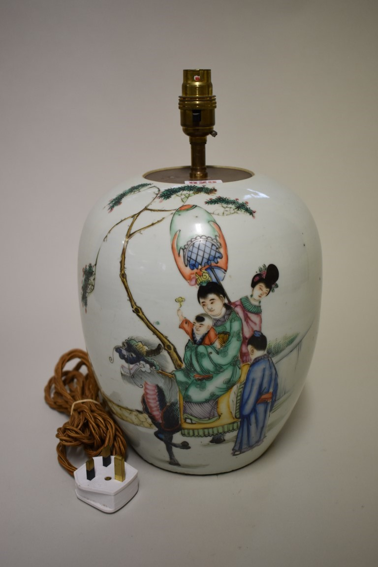 Lot 529 - A Chinese famille rose ovoid jar,painted with figures and a mythical creature,the back with five