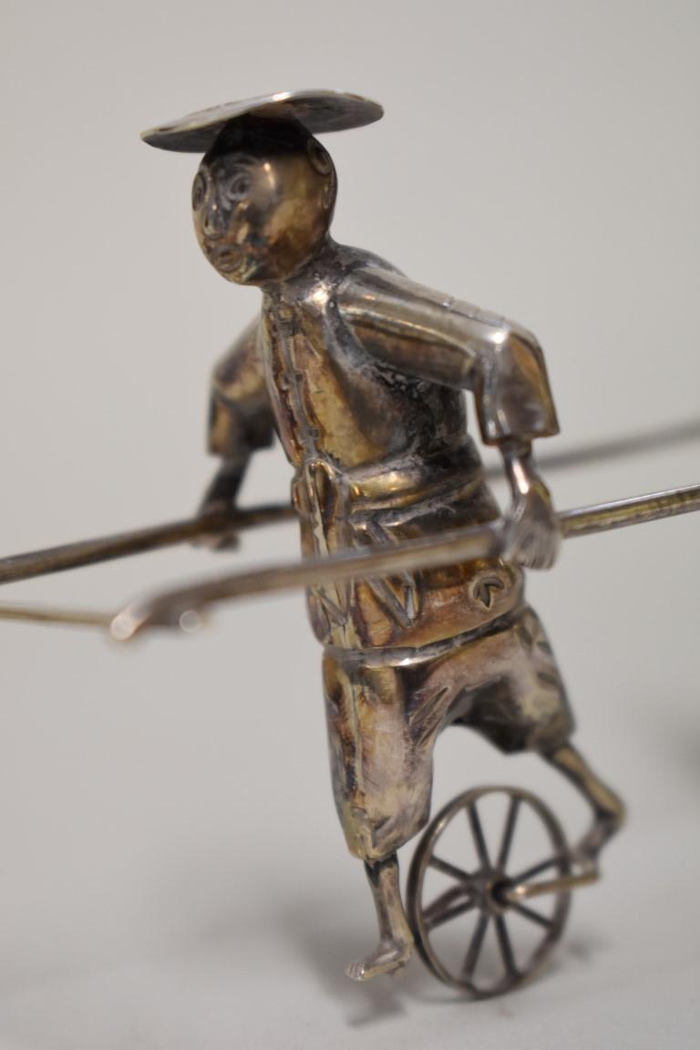 Lot 575 - A Chinese silver rickshaw cruet set, by Wai Kei, Hong Kong, stamped sterling, 21cm, 141g.