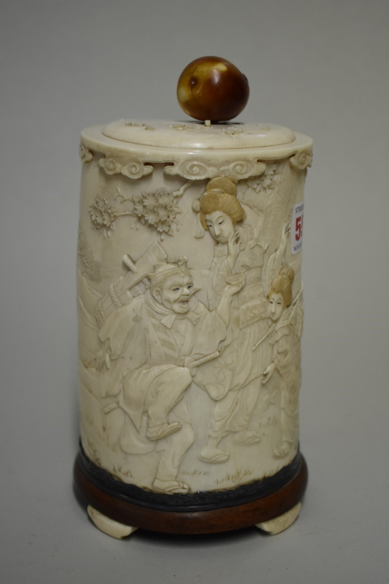 Lot 554 - A Japanese ivory tusk vase and cover, Meiji, carved in relief with a figure and geishas in a garden,