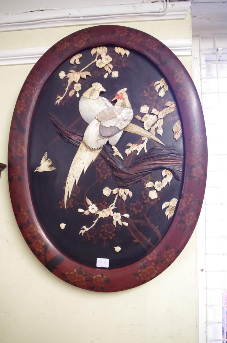 Lot 610A - A pair of Japanese lacquer and shibyama oval panels, decorated in high reliefwith bone and shell