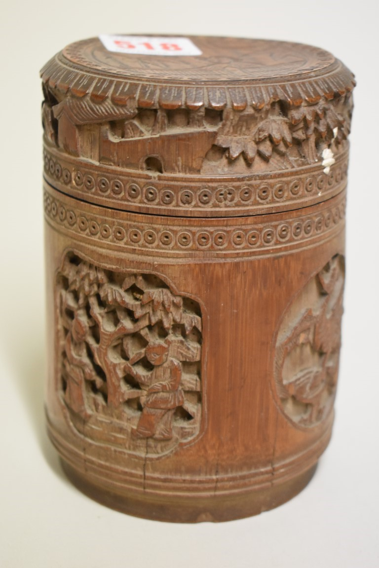 Lot 518 - A Chinese carved bamboo jar and cover, 14.5cm high; together with a Chinese hardwood and brass