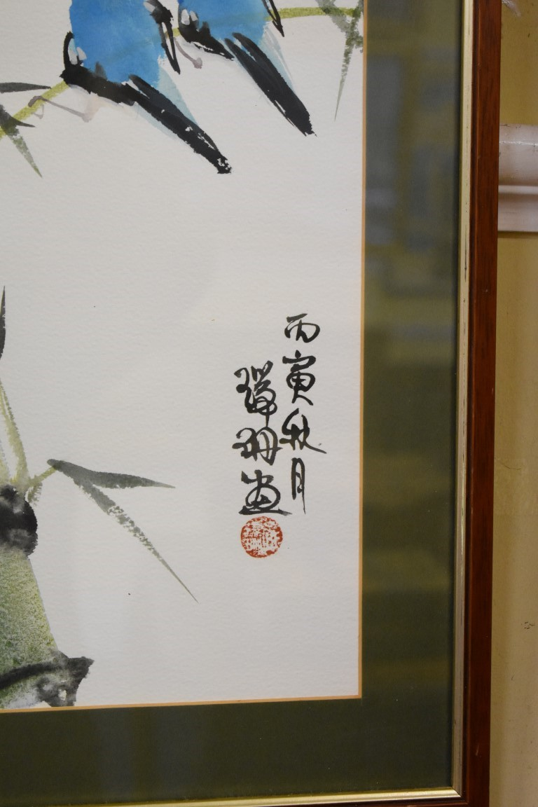 Lot 595 - Chinese School, a pair of exotic birds on a bamboo branch, signed, watercolour, 39 x 29.5cm.