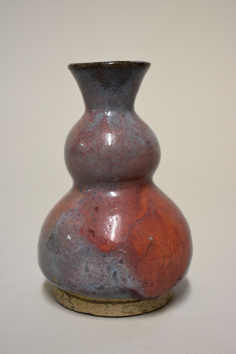 Lot 533 - A small Chinese Jun ware double gourd vase, probably 18th century, 11cm high.
