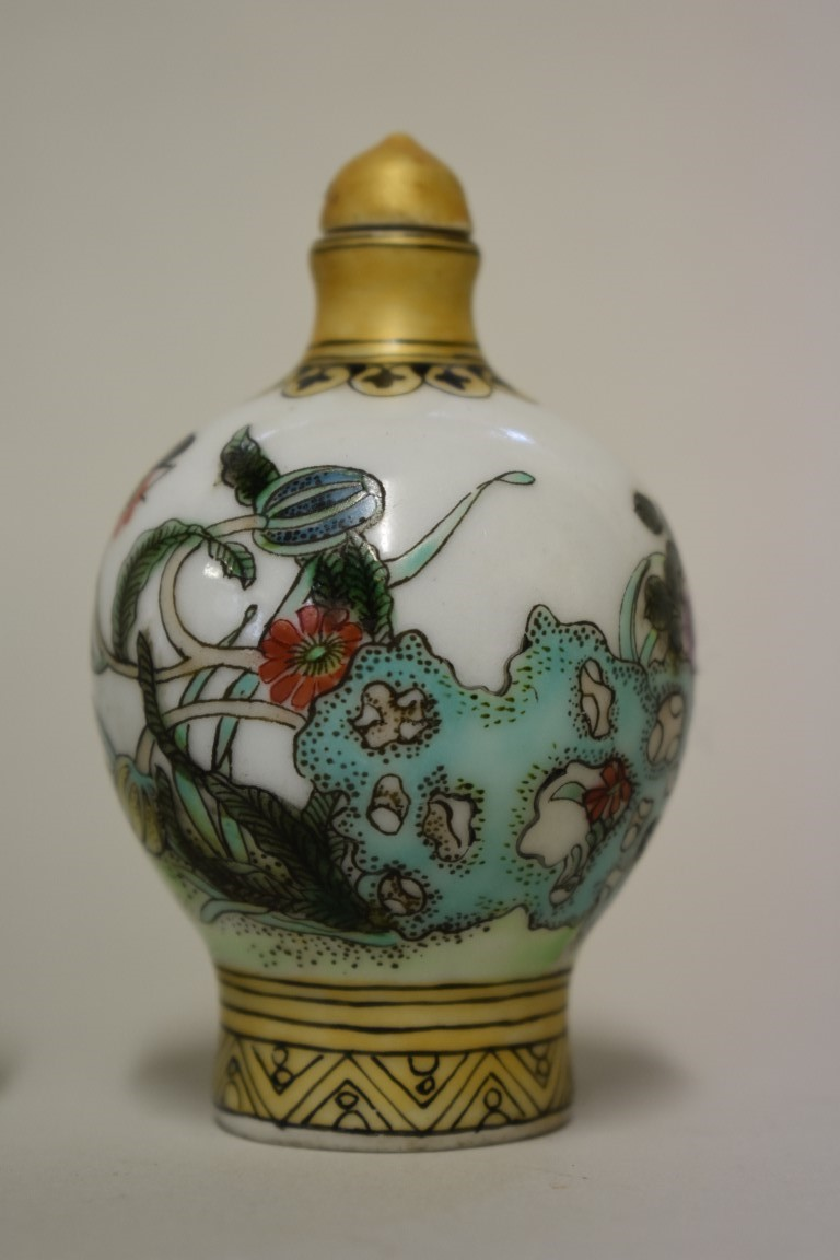 Lot 571 - Three Chinese snuff bottles, comprising: an internally painted rock crystal example, height
