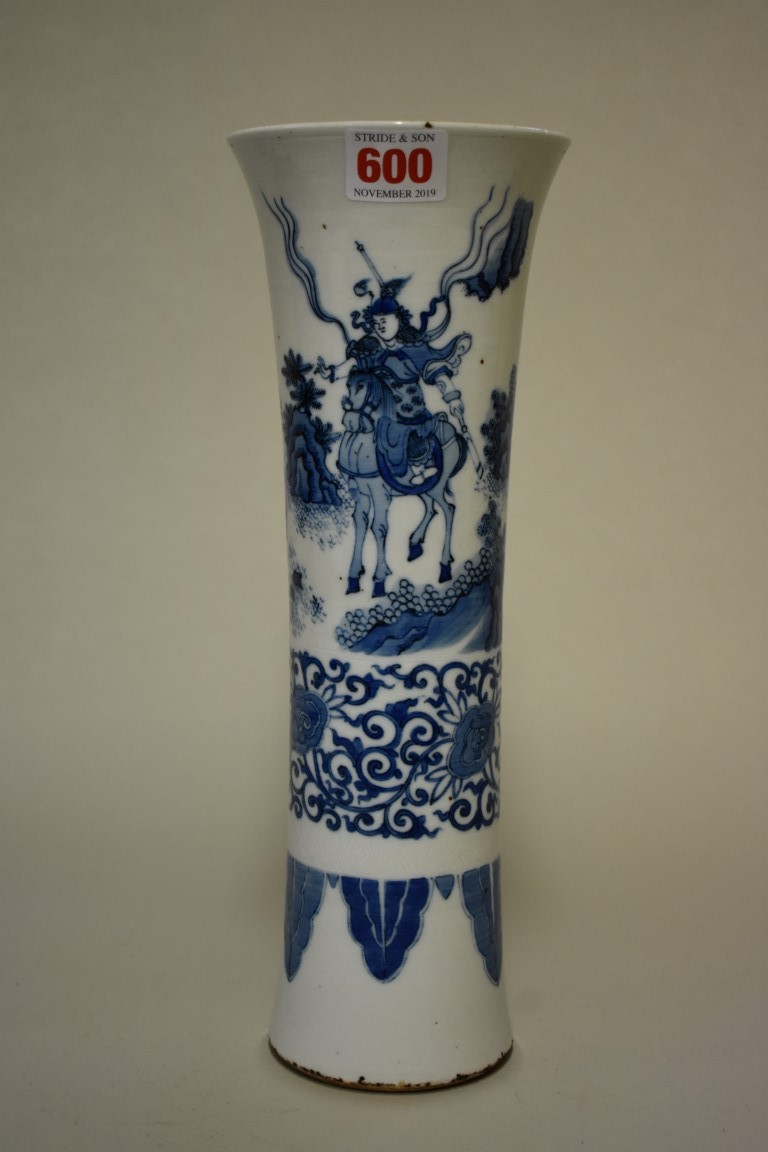 Lot 600 - A Chinese blue and white gu vase, painted with a continuous scene of figures in a landscape above