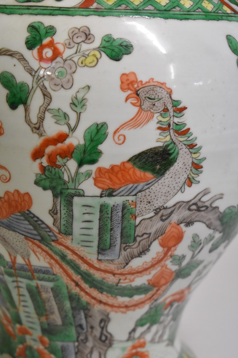 Lot 526 - A Chinese famille verte inverted baluster jar, 18th/19th century, painted with phoenix and flowering