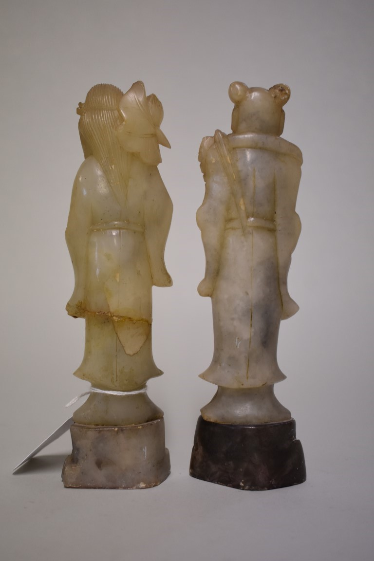 Lot 566 - A pair of Chinese soapstone figures, 18cm high, (one restuck). (2)