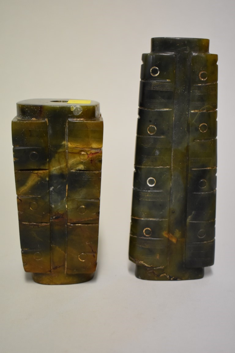 Lot 584 - Two Chinese mottled green jade ritualistic objects, largest 17.5cm high. (2)