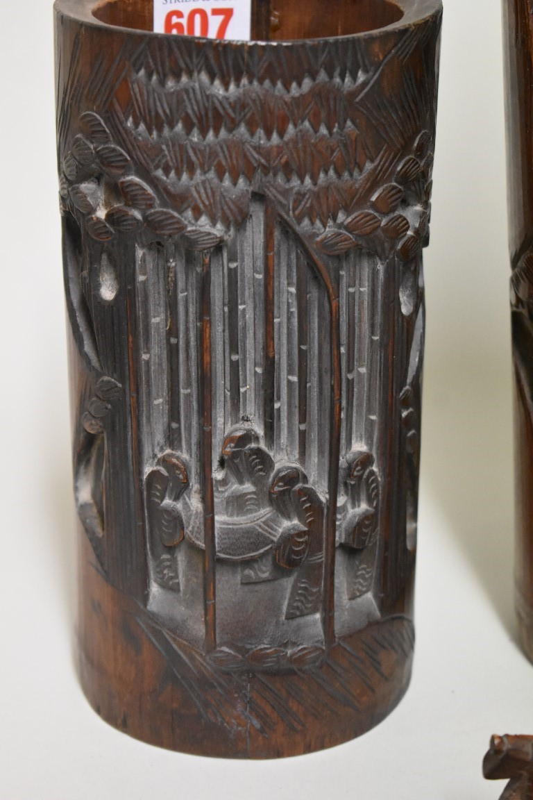 Lot 607 - Two Chinese carved bamboo vases, largest 32cm high; together with another carved bamboo boat,