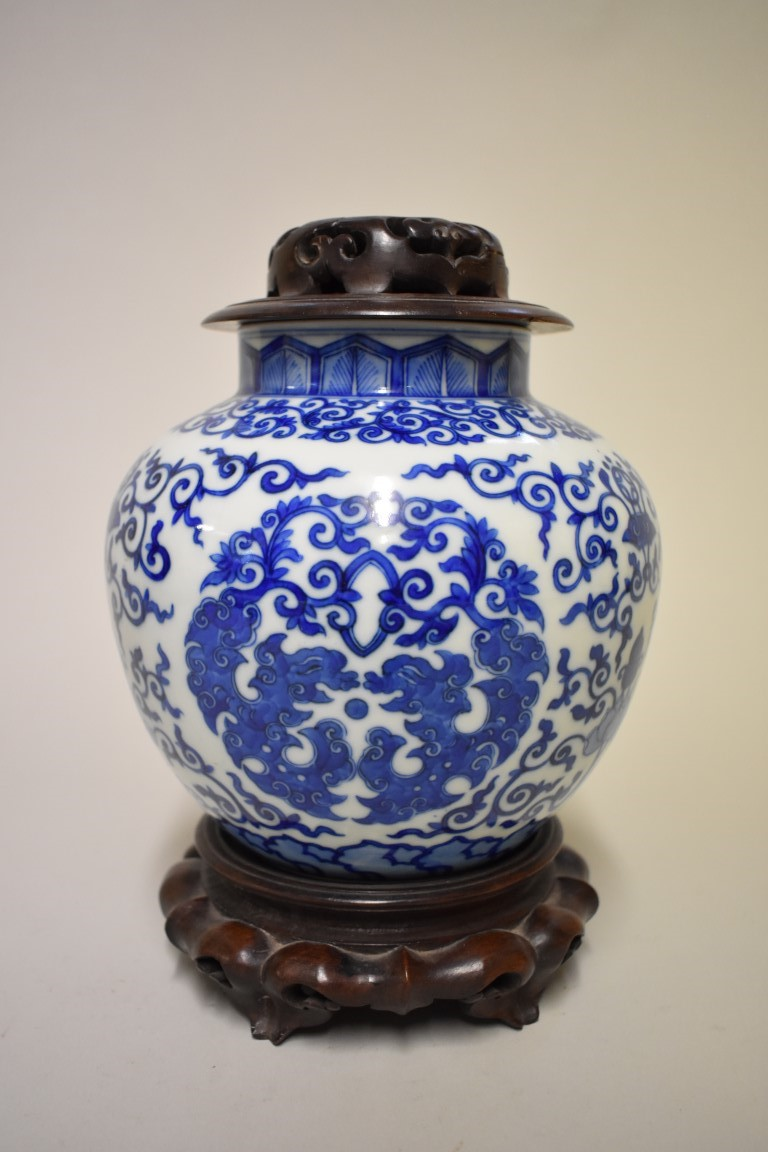 Lot 531 - A Chinese blue and white vase, Wanli six character mark, painted with stylized roundels and
