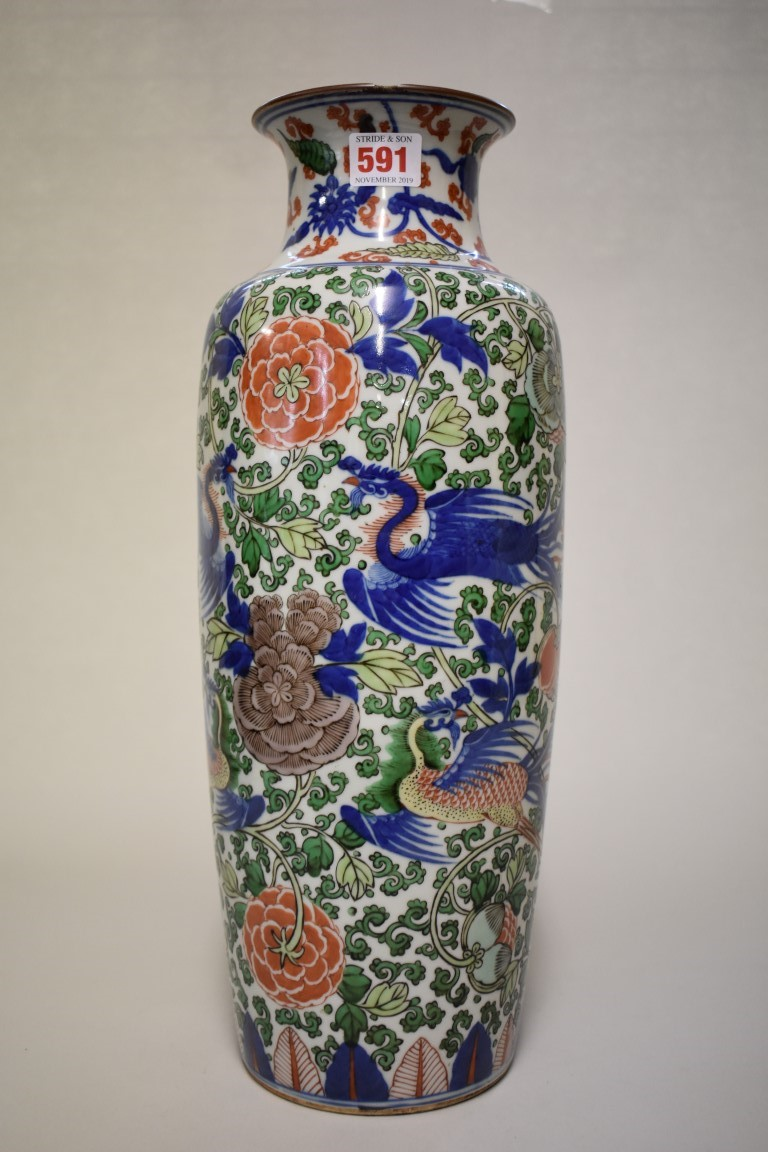 Lot 591 - A Chinese wucai Rouleau vase, Qing, painted with phoenix, 44cm high, (drilled through base, rim