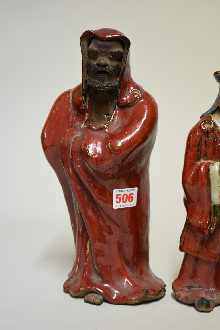 Lot 506 - Three Chinese Shiwan flambe figures, comprising: a Daoist, 30cm high; and a pair of attendants, 27cm