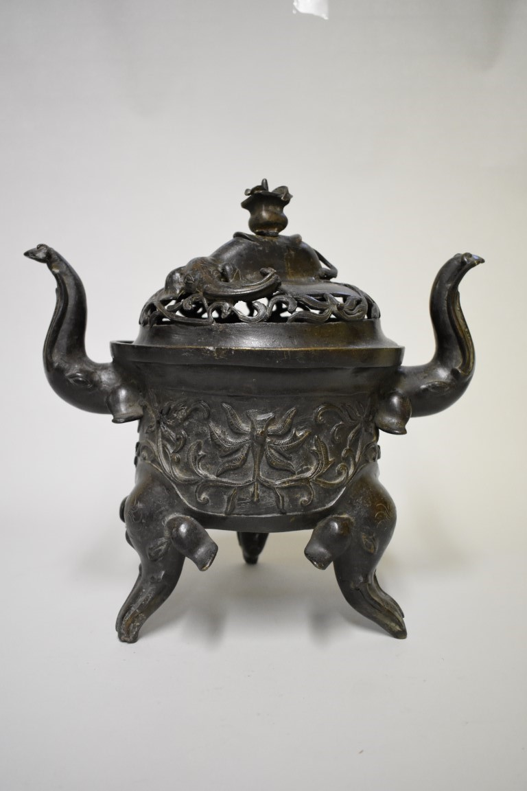 Lot 610 - A large Chinese bronze twin handled 'five elephant' tripod censer and cover, Ming, archaistic mark