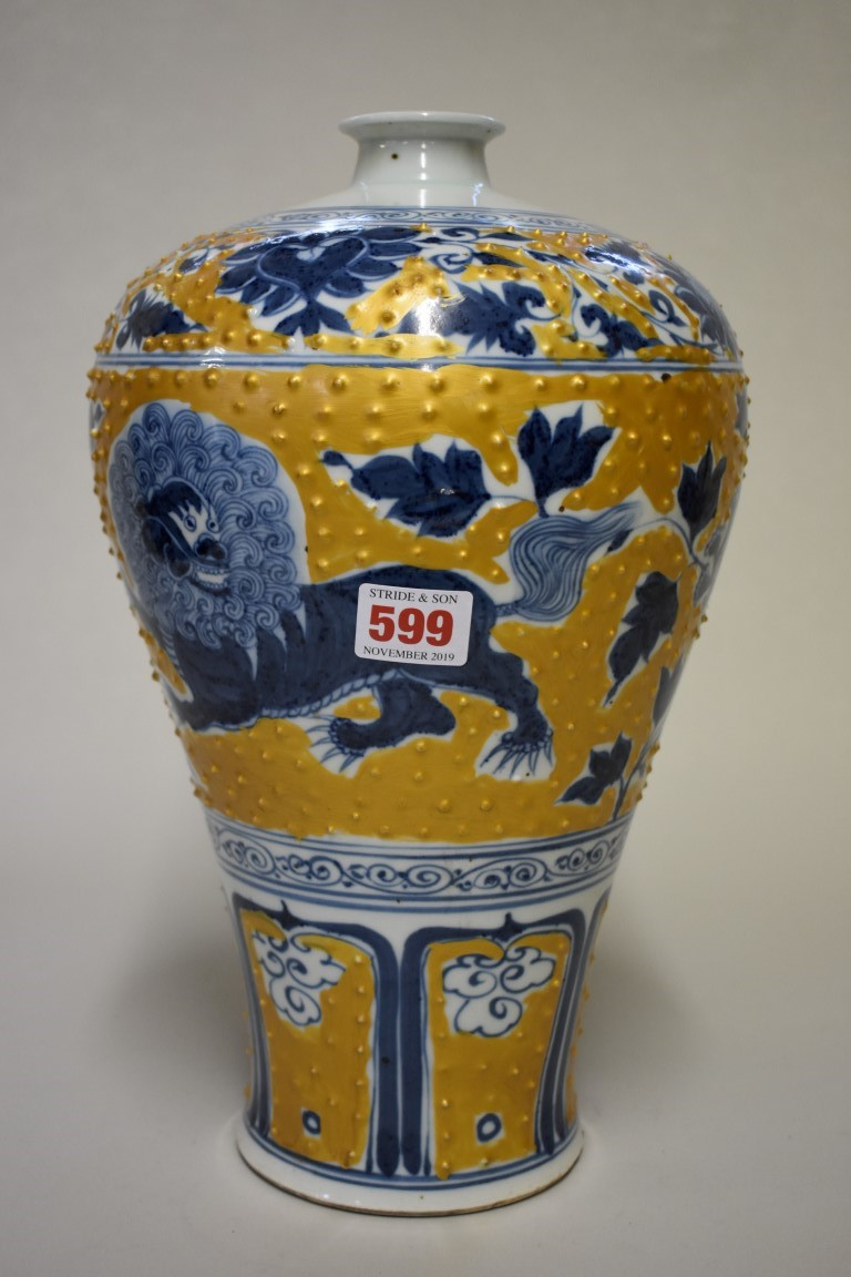 Lot 599 - A Chinese blue and white meiping vase, with gilt highlights, 33.5cm high.