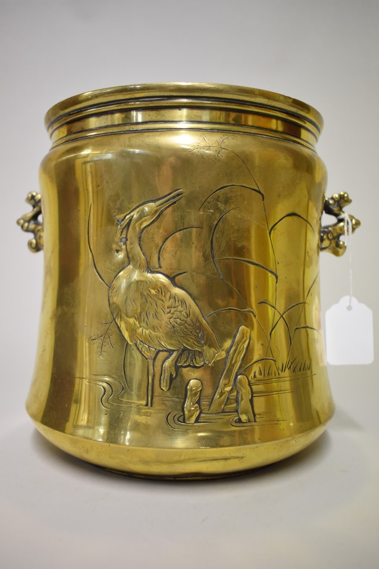 Lot 537 - A Chinese polished brass twin handled jardinière, relief moulded with cranes, 22cm high.
