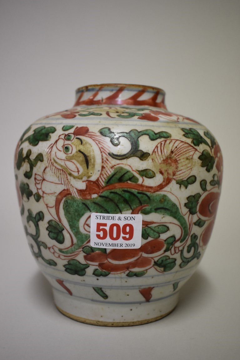 Lot 509 - A Chinese wucai jar, 17th century, painted with lion dogs and peonies, 17cm high.