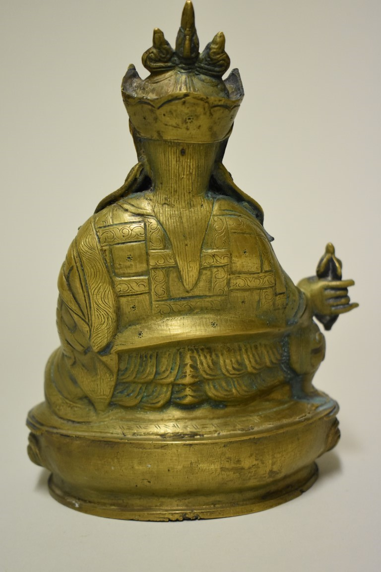 Lot 517 - A Sino-Tibetan bronze bodhisattva, possibly Wei Tuo or Skanda, probably Qing, holding a vajra in his