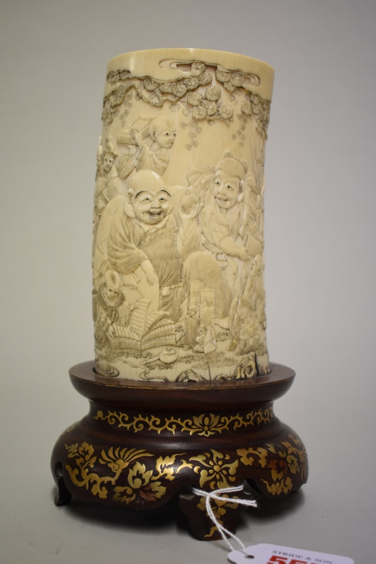 Lot 557 - A good Chinese ivory tusk vase, finely carved with a continuous band of figures, on giltdecorated