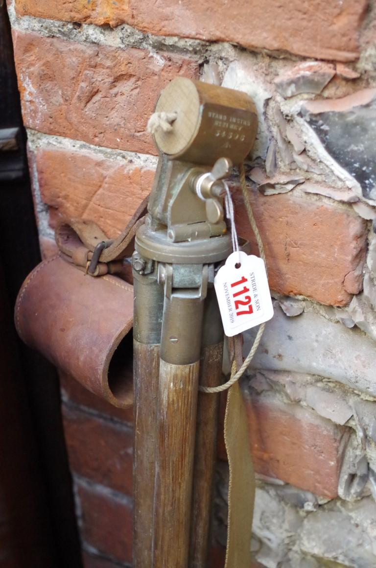 Lot 1127 - A World War II period oak and brass tripod,with broad arrow stamp.