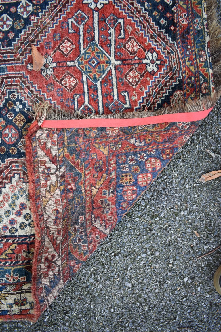 Lot 1108 - An Eastern rug,having three central medallions, with floral central field and geometric borders,