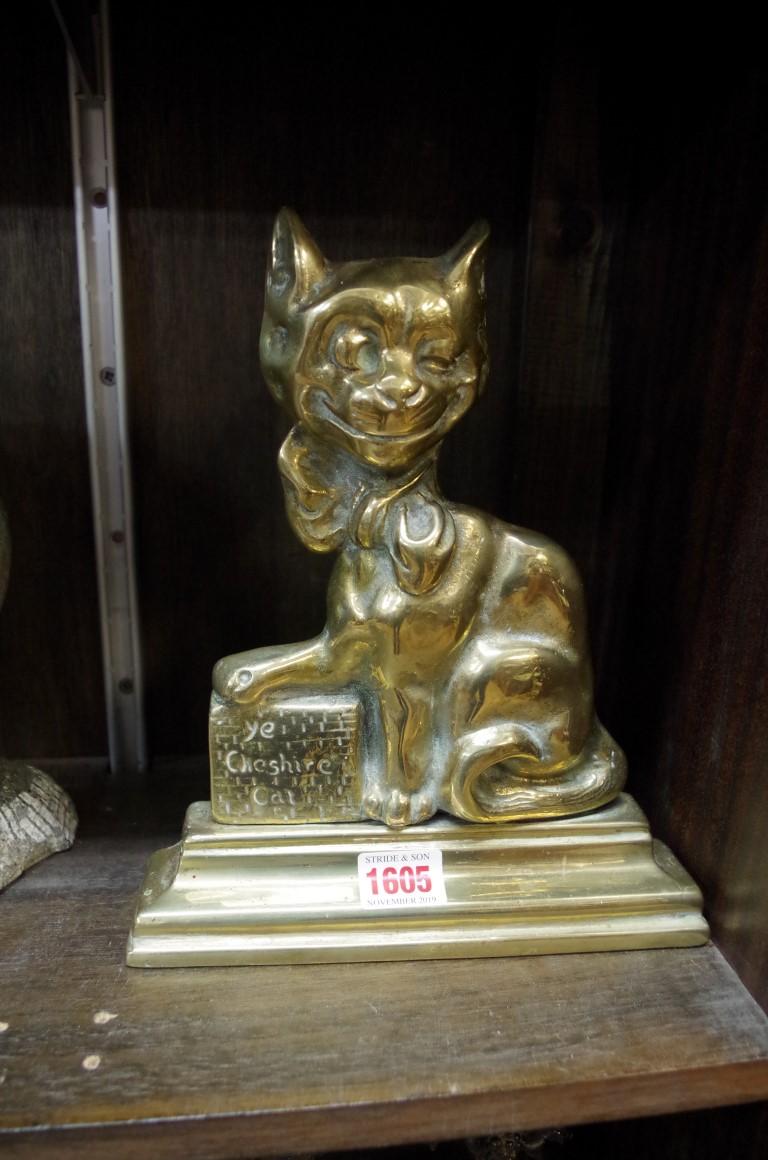Lot 1605 - A Victorian brass 'Ye Cheshire Cat' doorstop,25cm high.