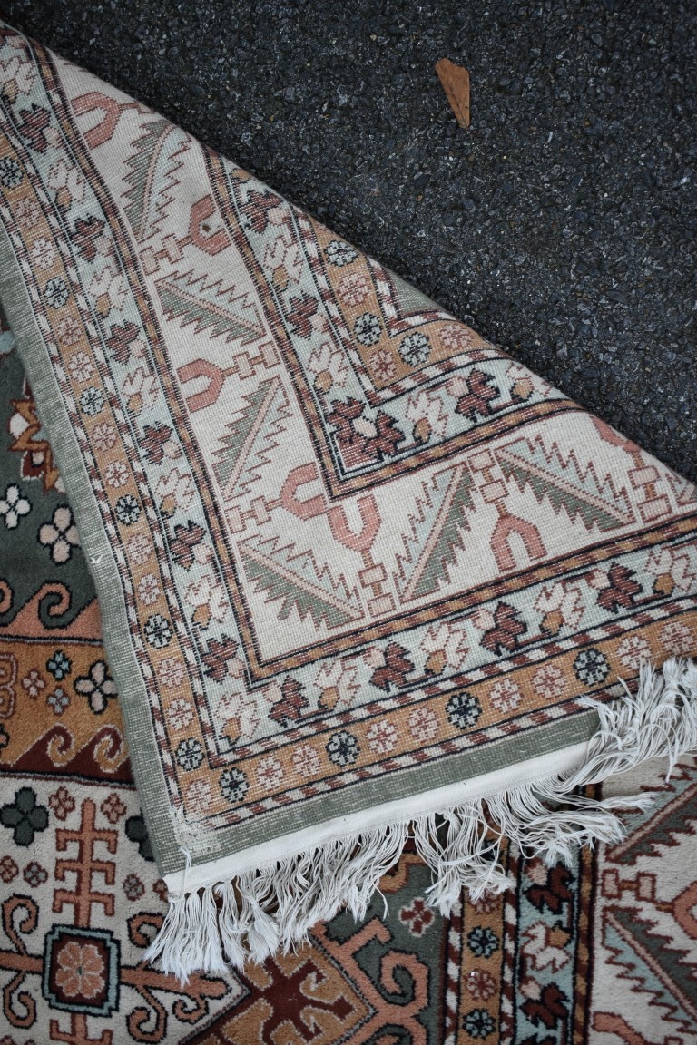 Lot 1116 - An Eastern rug, having two central medallions on a floral central field, with geometric borders, 225