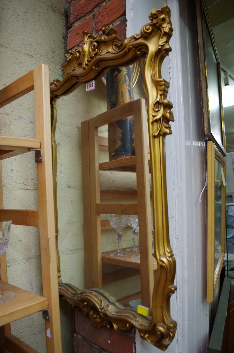Lot 1149 - A reproduction gilt framed wall mirror, 76 x 49cm.