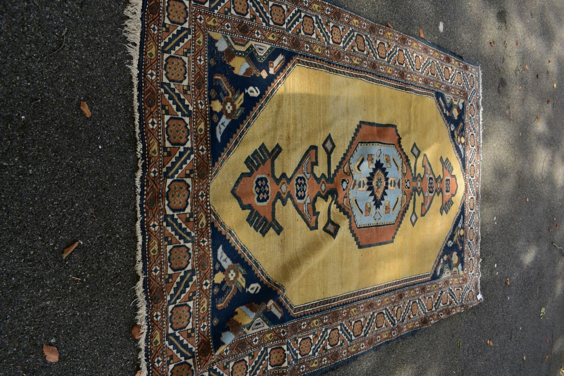Lot 1105 - A Turkish carpet,having yellow central field and geometric design, 297 x 195cm.