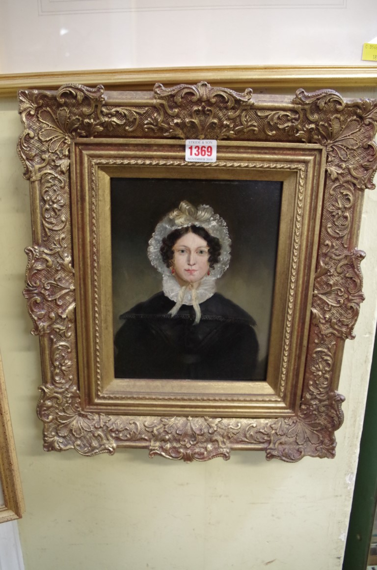 Lot 1369 - British School, 19th century, bust length portrait of a young woman with a lace bonnet, oil on