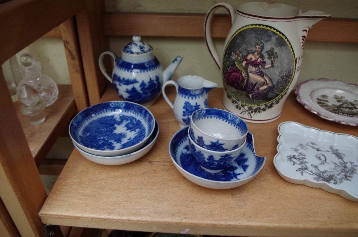 Lot 1153 - An interesting group of 18th and 19th century pottery and porcelain,to include a creamware jug,