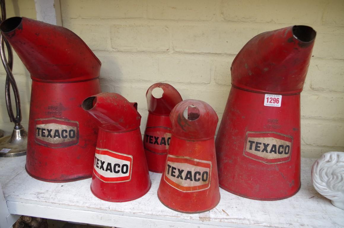 Lot 1296 - Five Texaco oil cans.