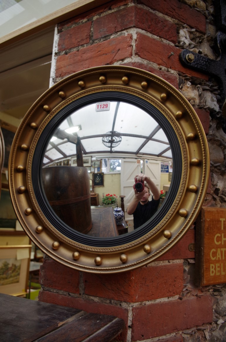 Lot 1129 - A reproduction gilt framed convex wall mirror, 41.5cm diameter.