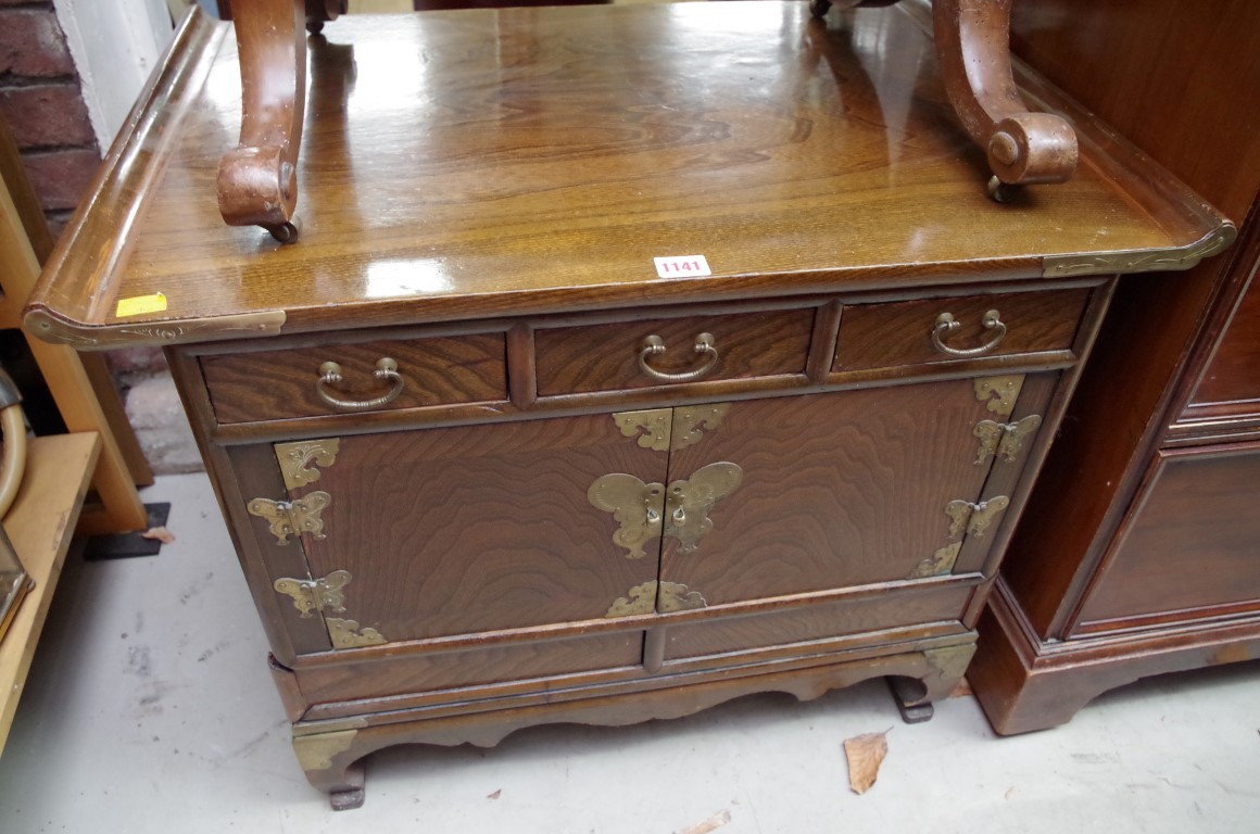 Lot 1141 - A Chinese or Korean elm low side cabinet,73.5cm wide.