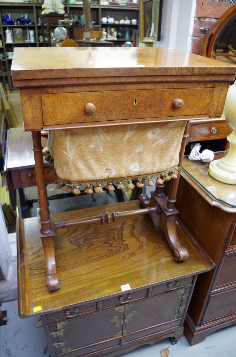 Lot 1140 - A 19th century burr walnut work table,with foldover swivel action top, 56cm wide.