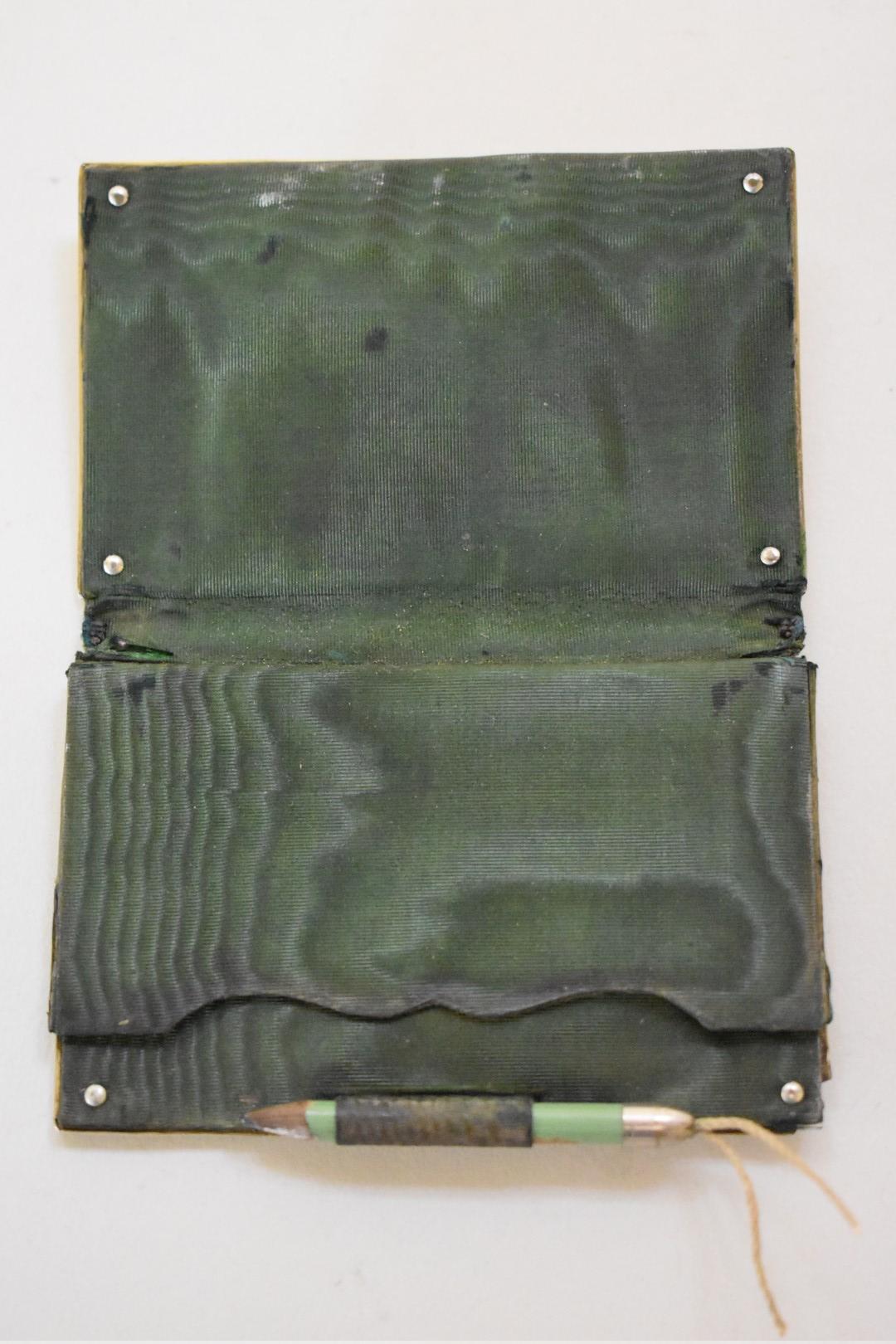 Lot 44 - A Victorian gilt metal silk lined aide memoir and card case, 9cm.