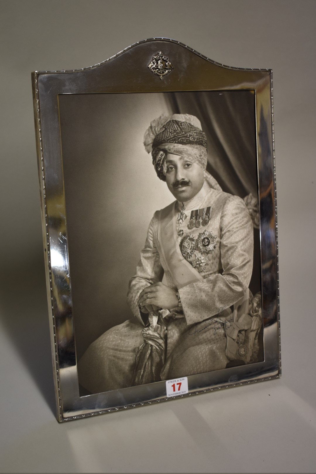 Lot 17 - A white metal framed photograph of Umaid Singh (1903-1944) Maharaja of Jodhpur, signed and dated