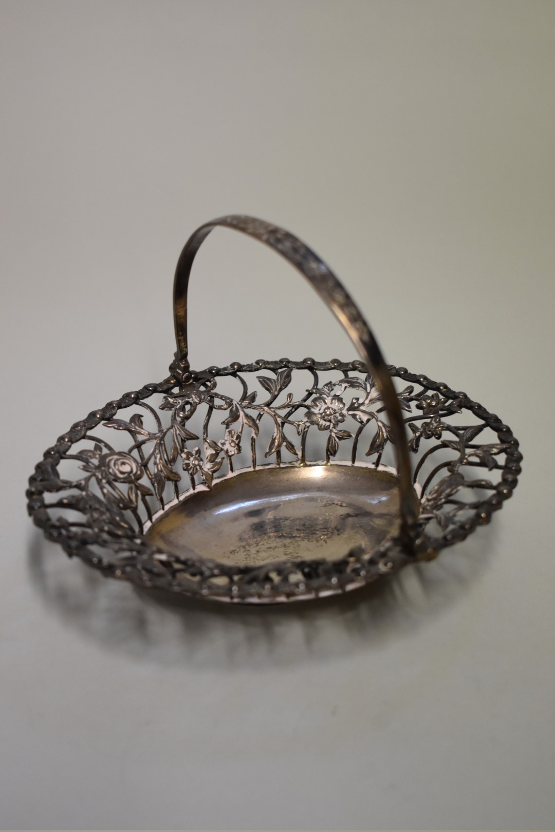 Lot 11 - A George III silver swing handled bonbon basket, makers mark indistinct,London 1762, 16cm, 166g.